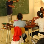 Plan lessons and teach English classes to children at the schoolhouse in town.