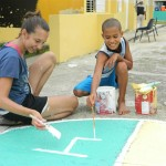 Repaint and refurbish the school's play area and plan a day where all the students are invited to help.