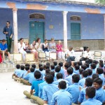 Perform a skit at a school assembly.