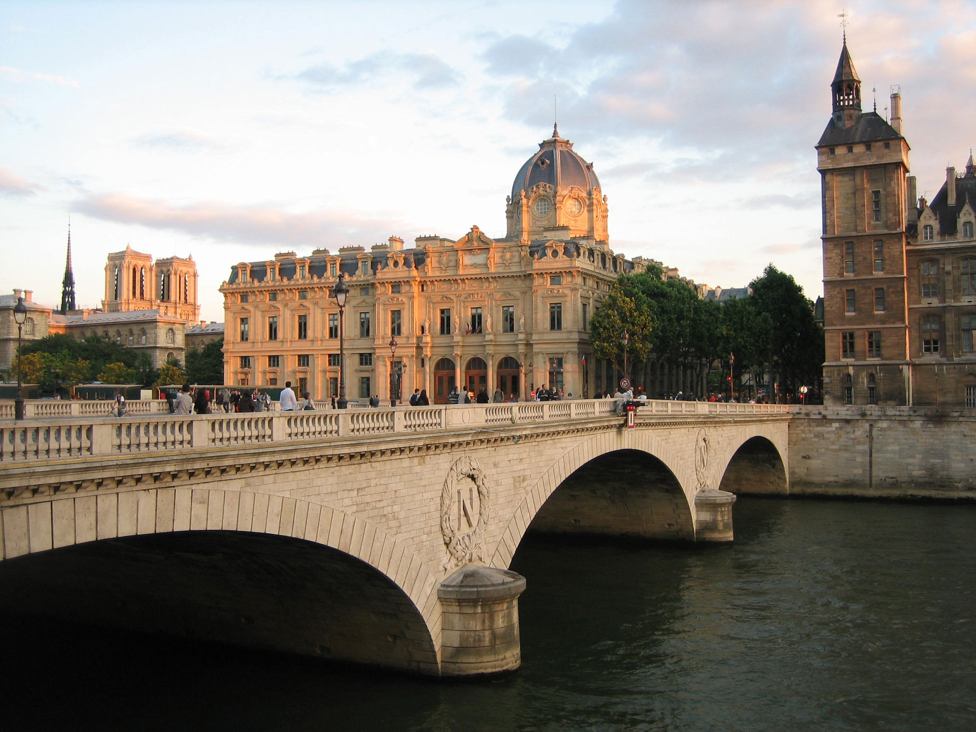 The late afternoon sun illuminates the monuments of Paris along the Seine.