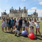 Posing for a victory shot after a hard-won game of Yogaball Soccer on the grounds of Chambord Castle in the Loire Valley.