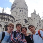 Students pose in front of the Sacre Coeur in Montmartre, Paris.