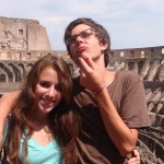 On a day trip to Rome, students contemplate Roman history at the Colosseum.