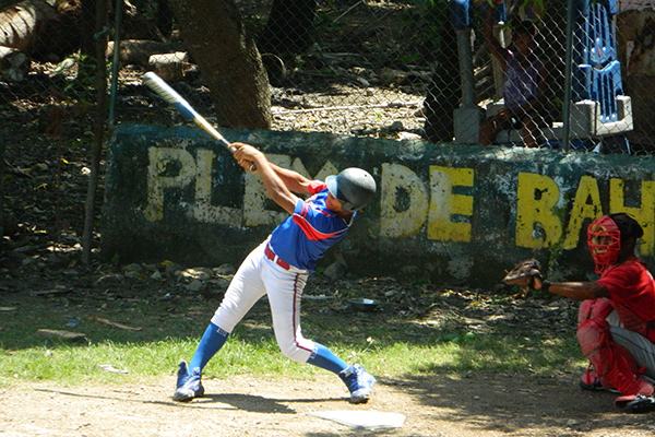 A baseball player swings for the fence on our Dominican Republic community service program