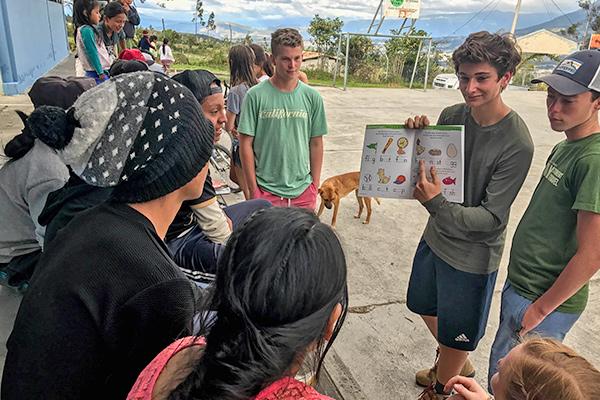 Students teach to local schoolchildren on our community service program in Ecuador