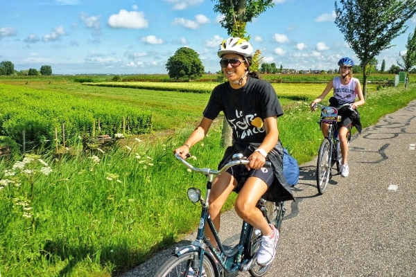 Bikers enjoy the Dutch Countryside on our cultural exploration program in Switzerland, Italy, France, and Holland