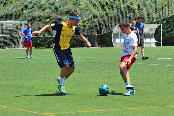 Students play soccer with locals on our language learning program in Spain