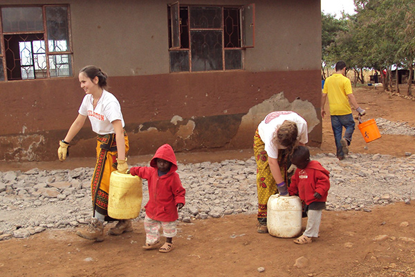 Students work on a community service project with local children on our community service program in Tanzania