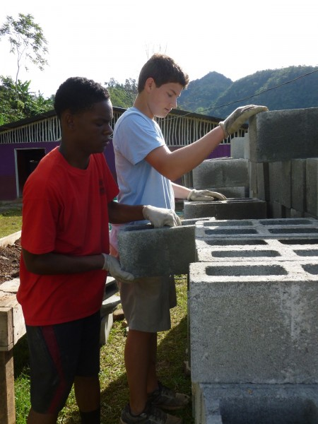 Tywone, left, works with a Putney friend on the project site in San Jose de Rivas, Costa Rica.