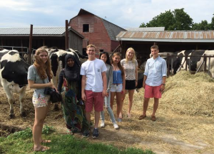 Fatumah, second from left, visits a farm in Amherst, MA.
