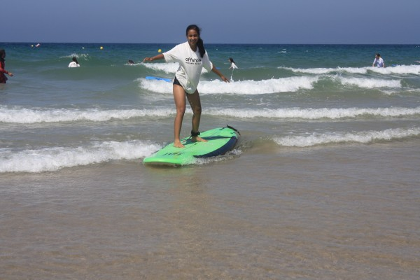 Sandy overcame her fear of water and took a surf lesson in Cadiz, Spain.