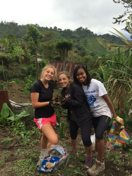 Niamani, right, poses with Putney friends in Las Tolas, Ecuador.
