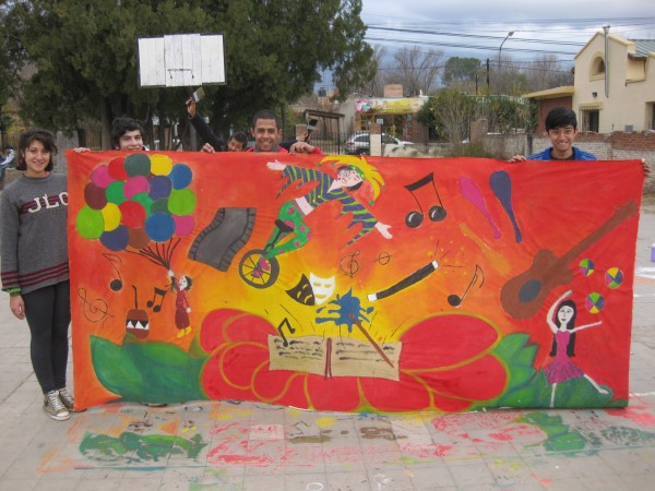 Austin, far right, created a mural with three Argentine friends