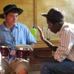 Learn Rwandan rhythms with local musicians .