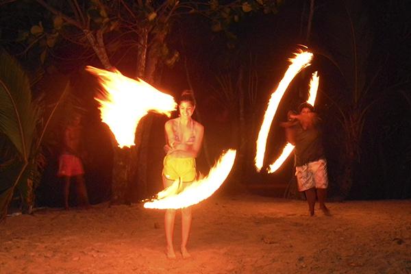Watch fire dancers on our community service program in Fiji