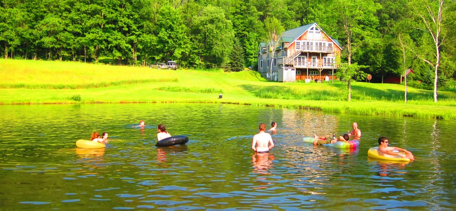 The Excel at Amherst College staff takes a dip in the Putney Student Travel pond during our annual barbecue at the Barn.