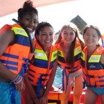 Don life jackets with your new friends while you cruise the blue water for other signs of marine life.