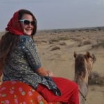 Teen Volunteer Rides Camel through Indian Desert