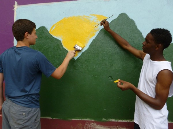 Matthew and Tywone working on the mural.