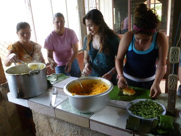 Two of the local ticas, Raquel and Milady, and two of our students, Katherine and Amanda, work together to make tamales!