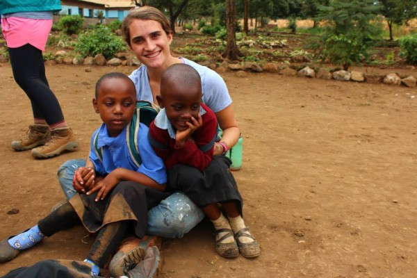 Madison Bailey with local friends on our community service program in Tanzania.