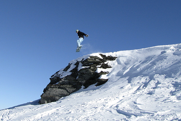 Snowboarders and skiers enjoy perfect conditions on our cultural exploration program in Patagonia