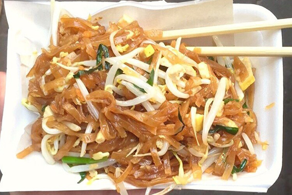 Sample delicious pad thai on our cultural exploration program in Thailand, Laos, and Cambodia