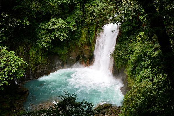 Students swim in hidden waterfalls in the rainforest on our community service program on Costa Rica