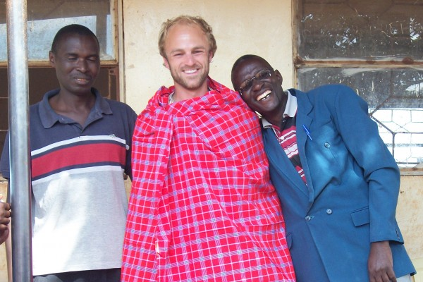 John with community contacts in Tanzania.
