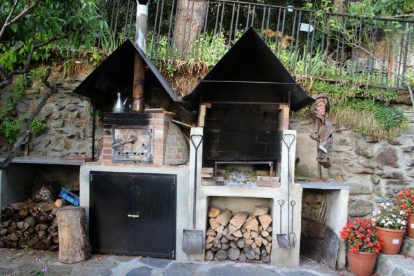 A Wood-fired oven and grill - ready to fire up for a loaf of bread or some delicious Catalan calçots.